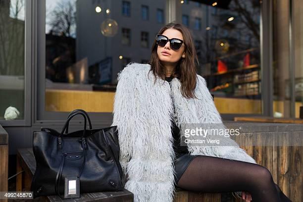 Maxilie Mlinarskij is wearing HM jacket Balenciaga bag Gentle Monster sunglasses on November 27 2015 in Berlin Germany