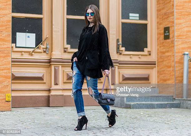 Maxilie Mlinarskij seen wearing a black fringe jacket from HM blue ripped jeans from Zara black heels with fringes from Sam Edelmann Zero Vintage...