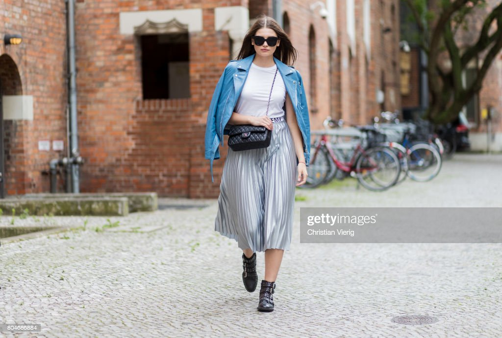 Maxilie Mlinarskij wearing a silver midi skirt Mango, a white tshirt H&M, a blue leather jacket Be Edgy, black Topshop boots, black Chanel bag, Zero Vintage sunglasses on June 30, 2017 in Berlin, Germany.