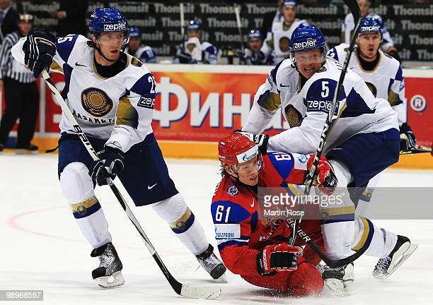 Maxim Afinogenov of Russia and Alexei Litvinenko of Kazakhstan battle for the puck during the IIHF World Championship group A match between Russia...