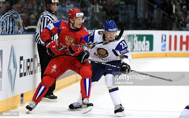 Maxim Afinogenov of Russia and Andrei Spiridonov of Kazakhstan battle for the puck during the IIHF World Championship group A match between Russia...