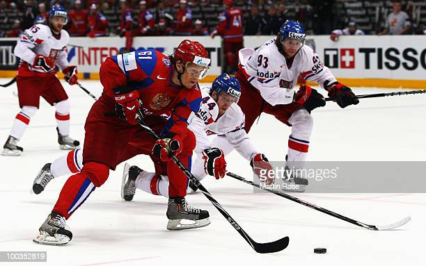 Maxim Afinogenov of Russia and Miroslac Blatak of Czech Republic battle for the puck during the IIHF World Championship gold medal match between...