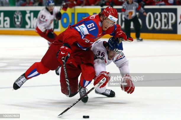 Maxim Afinogenov of Russia and Petr Caslava of Czech Republic battle for the puck during the IIHF World Championship gold medal match between Russia...