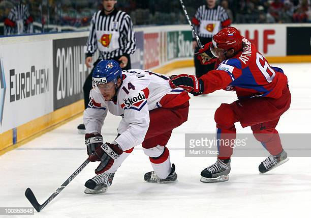 Maxim Afinogenov of Russia and Petr Vampola of Czech Republic battle for the puck during the IIHF World Championship gold medal match between Russia...