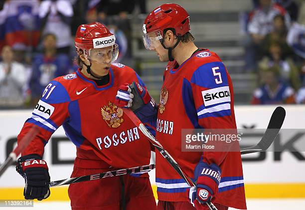 Maxim Afinogenov of Russia talks to team mate Ilya Nikulin during the IIHF World Championship group A match between Russia and Slovenia at Orange...