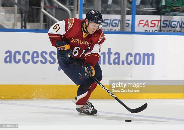Maxim Afinogenov of the Atlanta Thrashers carries the puck against the Washington Capitals at Philips Arena on October 29 2009 in Atlanta Georgia