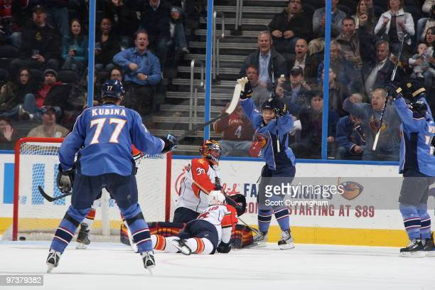Maxim Afinogenov of the Atlanta Thrashers celebrates after a goal by Todd White against the Florida Panthers at Philips Arena on March 2 2010 in...