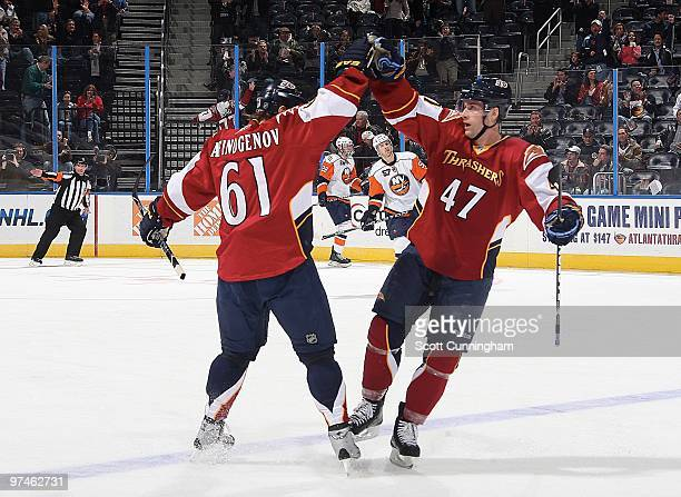 Maxim Afinogenov of the Atlanta Thrashers is congratulated by Rich Peverley after scoring a goal against the New York Islanders at Philips Arena on...