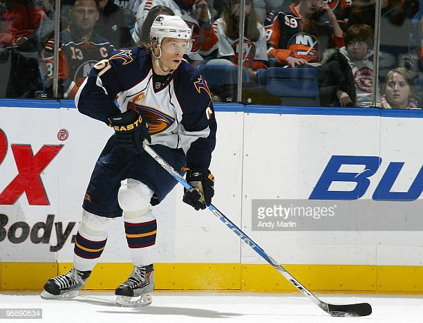 Maxim Afinogenov of the Atlanta Thrashers plays the puck against the New York Islanders during the game at the Nassau Coliseum on January 02 2010 in...