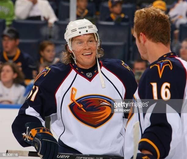 Maxim Afinogenov of the Atlanta Thrashers shares a laugh with teammate Christoph Schubert before their game against the Buffalo Sabres on October 17...