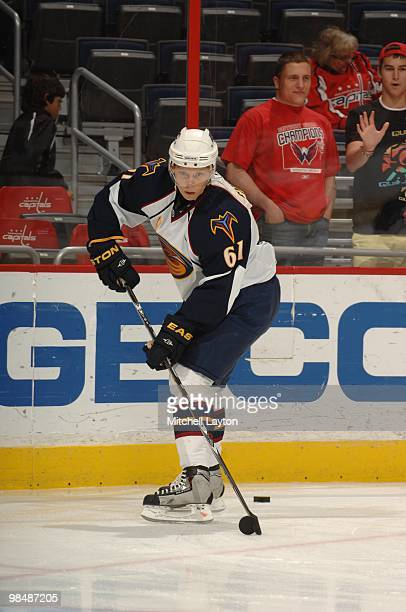 Maxim Afinogenov of the Atlanta Thrashers skates with the puck during a NHL hockey game against the Washington Capitals on April 9 2010 at the...