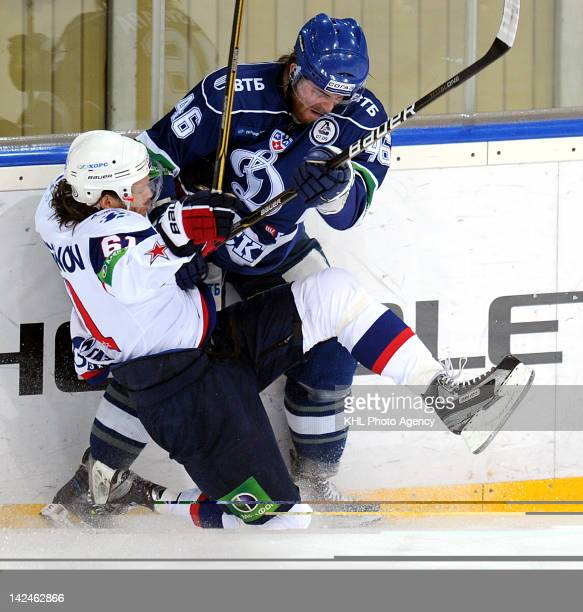 Maxim Afinogenov of the SKA collides with Janne Jalasvaara of the Dinamo during the playoff game between SKA St Petersbourg and Dinamo Moscow during...