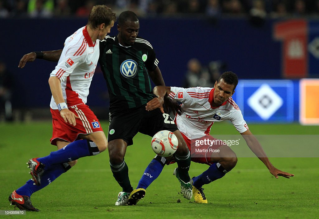 Maxim Choupo Moting (R) of Hamburg and Grafite (C) of Wolfsburg battle for the ball during the Bundesliga match between Hamburger SV and VFL Wolfsburg at Imtech Arena on September 22, 2010 in Hamburg, Germany.