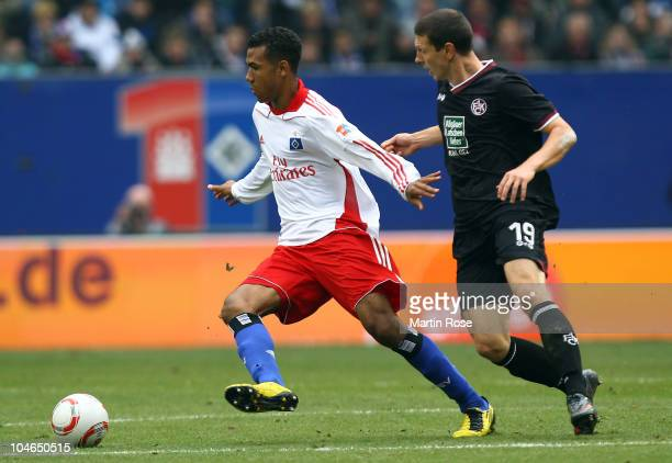Maxim Choupo Moting of Hamburg and Jiri Bilek of Kaiserslautern compete for the ball during the Bundesliga match between Hamburger SV and 1 FC...