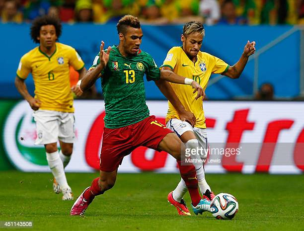 Maxim ChoupoMoting of Cameroon battles with Neymar of Brazil during the 2014 FIFA World Cup Brazil Group A match between Cameroon and Brazil at...