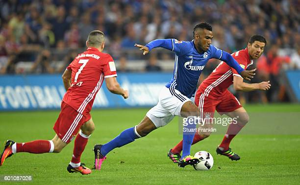 Maxim ChoupoMoting of Schalke is chased by Franck Ribrry of Bayern Muenchen during the Bundesliga match between FC Schalke 04 and Bayern Muenchen at...