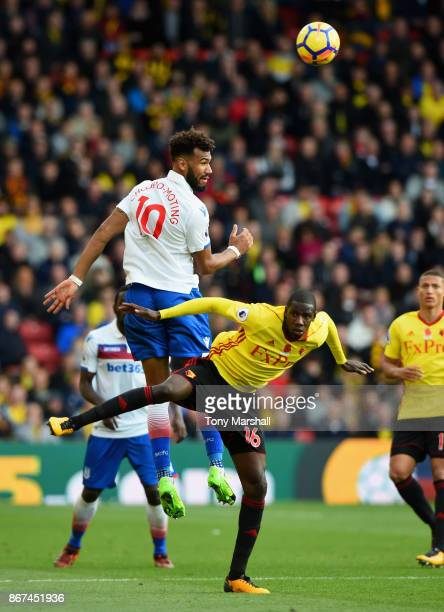 Maxim ChoupoMoting of Stoke City and Abdoulaye Doucoure of Watford in action during the Premier League match between Watford and Stoke City at...