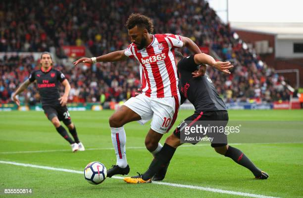 Maxim ChoupoMoting of Stoke City and Sead Kolasinac of Arsenal battle for possession during the Premier League match between Stoke City and Arsenal...