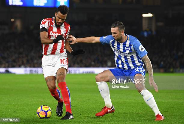 Maxim ChoupoMoting of Stoke City and Solly March of Brighton and Hove Albion in action during the Premier League match between Brighton and Hove...