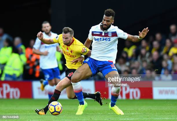 Maxim ChoupoMoting of Stoke City and Tom Cleverley of Watford battle for possession during the Premier League match between Watford and Stoke City at...