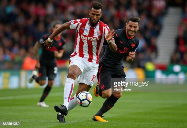Maxim ChoupoMoting of Stoke City attempts to get away from Sead Kolasinac of Arsenal during the Premier League match between Stoke City and Arsenal...