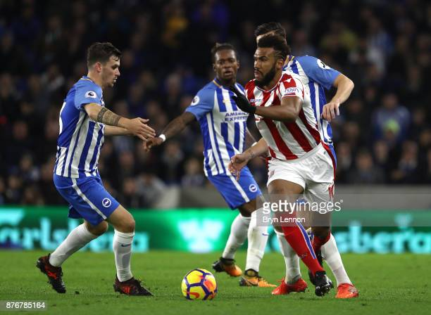 Maxim ChoupoMoting of Stoke City avoids a tackle from Dale Stephens of Brighton and Hove Albion during the Premier League match between Brighton and...