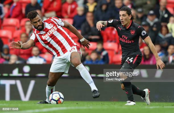 Maxim ChoupoMoting of Stoke City controls the ball as Hector Bellerin challenges during the Premier League match between Stoke City and Arsenal at...