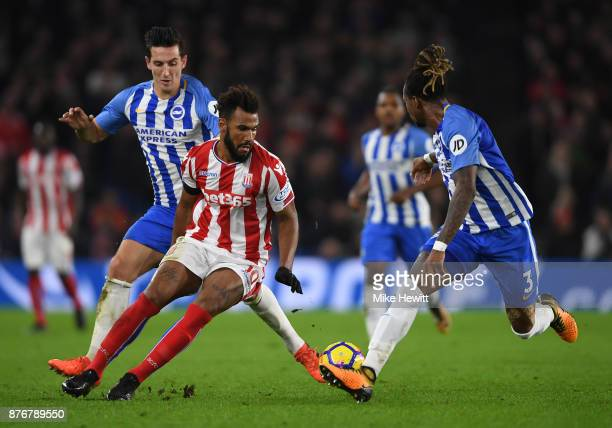 Maxim ChoupoMoting of Stoke City is closed down by Gaetan Bong of Brighton and Hove Albion and Lewis Dunk of Brighton and Hove Albion during the...