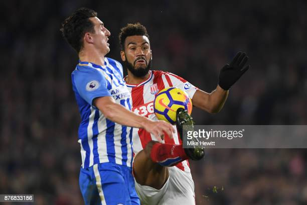 Maxim ChoupoMoting of Stoke is challenged by Lewis Dunk of Brighton during the Premier League match between Brighton and Hove Albion and Stoke City...