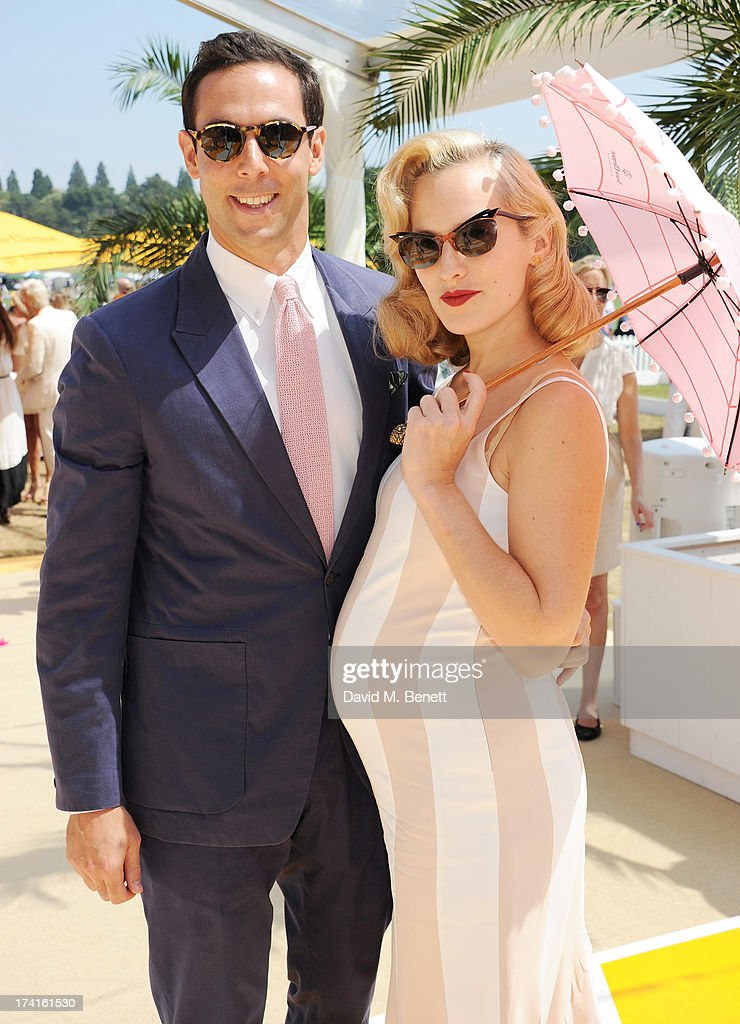 Maxim Crewe (L) and Charlotte Dellal attend the Veuve Clicquot Gold Cup Final at Cowdray Park Polo Club on July 21, 2013 in Midhurst, England.