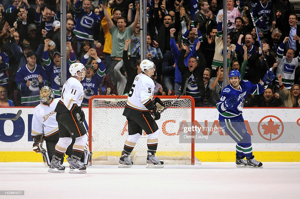 Maxim Lapierre celebrates the goal of his teammate Alexandre Burrows of the Vancouver Canucks on Jonas Hiller of the Anaheim Ducks in NHL action on...