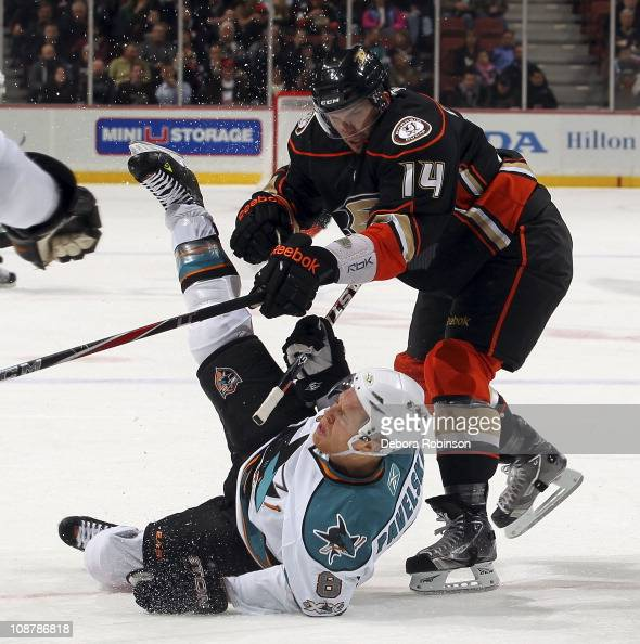 Maxim Lapierre of the Anaheim Ducks collides against Joe Pavelski of the San Jose Sharks during the game on February 3 2011 at Honda Center in...