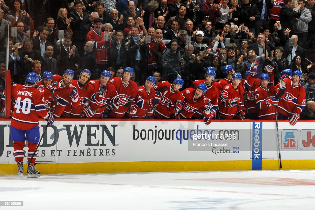 Maxim Lapierre of the Montreal Canadiens and teammate celebrates the winning goal during the NHL game against the Carolina Hurricanes on November 17...