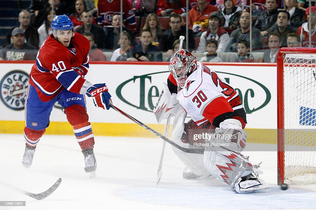 Maxim Lapierre of the Montreal Canadiens scores a goal on Cam Ward of the Carolina Hurricanes during the NHL game at the Bell Centre on November 13...