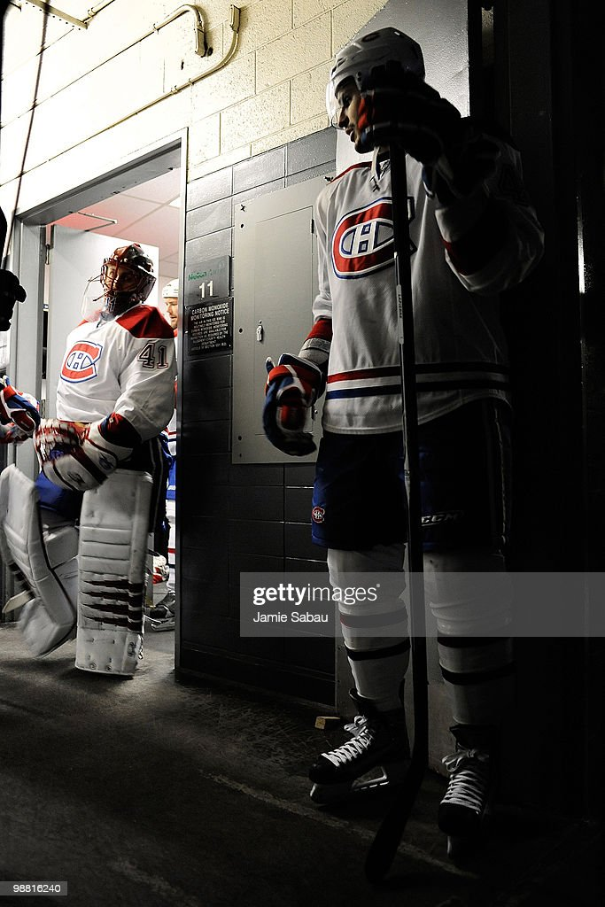 Maxim Lapierre of the Montreal Canadiens waits for goaltender Jaroslav Halak of the Montreal Canadiens to lead the team from the dressing room to the...