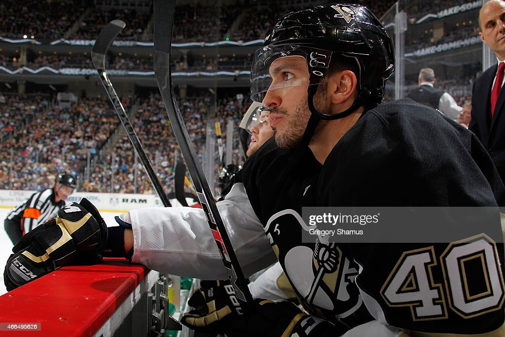 Maxim Lapierre #40 of the Pittsburgh Penguins looks on from the bench during the game against the Edmonton Oilers at Consol Energy Center on March 12, 2015 in Pittsburgh, Pennsylvania.