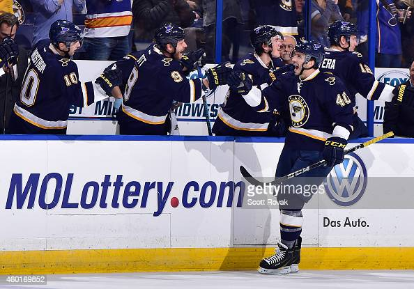 Maxim Lapierre of the St Louis Blues celebrates his goal with Steve Ott during a game against the Florida Panthers on December 8 2014 at Scottrade...