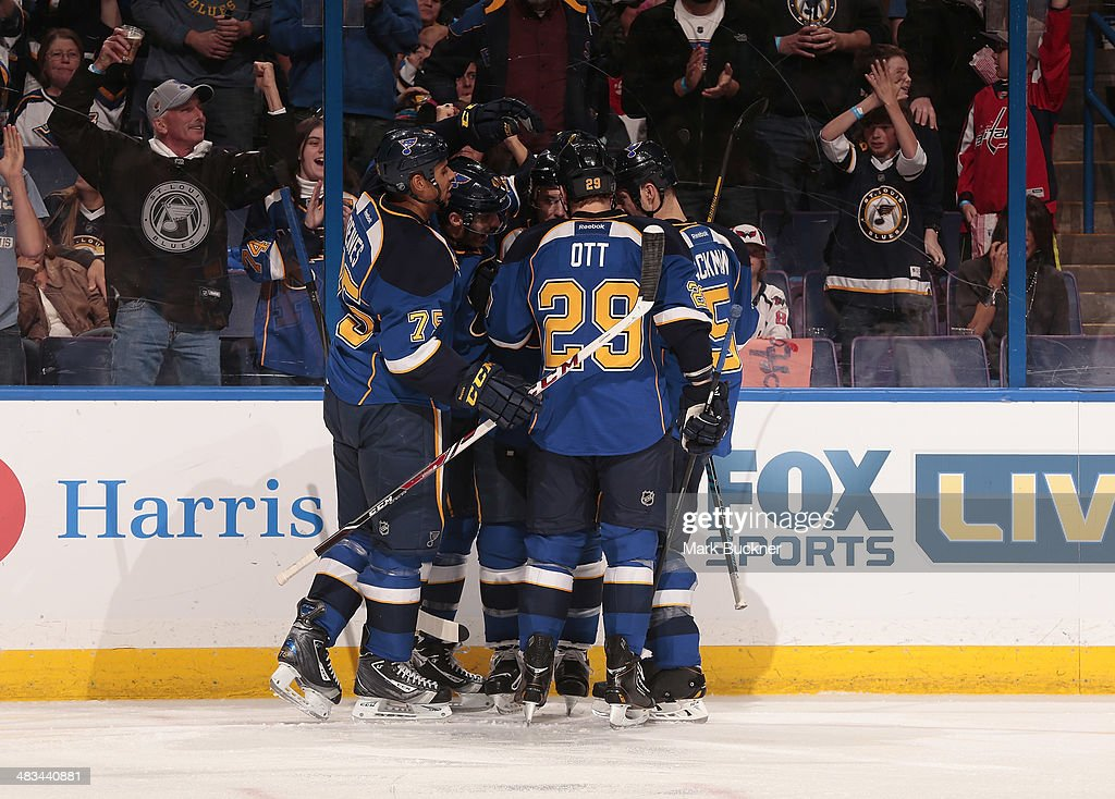 <a gi-track='captionPersonalityLinkClicked' href=/galleries/search?phrase=Maxim+Lapierre&family=editorial&specificpeople=718385 ng-click='$event.stopPropagation()'>Maxim Lapierre</a> #40 of the St. Louis Blues is congratulated by teammates after scoring a goal against the Washington Capitals during an NHL game on April 8, 2014 at Scottrade Center in St. Louis, Missouri.