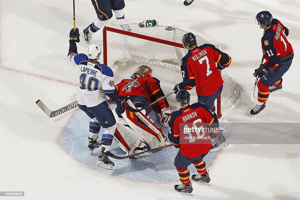 <a gi-track='captionPersonalityLinkClicked' href=/galleries/search?phrase=Maxim+Lapierre&family=editorial&specificpeople=718385 ng-click='$event.stopPropagation()'>Maxim Lapierre</a> #40 of the St. Louis Blues raises his stick to celebrate the goal by teammate Derek Roy #12 (not pictured) against goaltender <a gi-track='captionPersonalityLinkClicked' href=/galleries/search?phrase=Jacob+Markstrom&family=editorial&specificpeople=5370948 ng-click='$event.stopPropagation()'>Jacob Markstrom</a> #25 of the Florida Panthers at the BB&T Center on November 1, 2013 in Sunrise, Florida. The Blues defeated the Panthers 4-0.