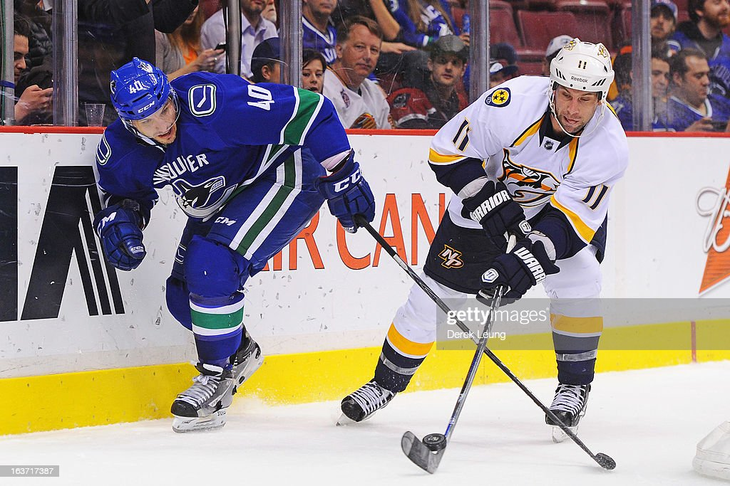 <a gi-track='captionPersonalityLinkClicked' href=/galleries/search?phrase=Maxim+Lapierre&family=editorial&specificpeople=718385 ng-click='$event.stopPropagation()'>Maxim Lapierre</a> #40 of the Vancouver Canucks battles for the puck against <a gi-track='captionPersonalityLinkClicked' href=/galleries/search?phrase=David+Legwand&family=editorial&specificpeople=202553 ng-click='$event.stopPropagation()'>David Legwand</a> #11 of the Nashville Predators during an NHL game at Rogers Arena on March 14, 2013 in Vancouver, British Columbia, Canada. The Vancouver Canucks won 7-4.