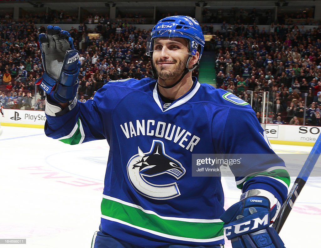 <a gi-track='captionPersonalityLinkClicked' href=/galleries/search?phrase=Maxim+Lapierre&family=editorial&specificpeople=718385 ng-click='$event.stopPropagation()'>Maxim Lapierre</a> #40 of the Vancouver Canucks celebrates shootout goal against the Columbus Blue Jackets during their NHL game at Rogers Arena March 26, 2013 in Vancouver, British Columbia, Canada. Vancouver won 1-0.