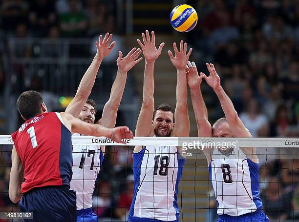 Maxim MikhaylovAlexander Volkov and Sergey Tetyukhin of Russia try to block a spike from Matthew Anderson of the United States on Day 8 of the London...