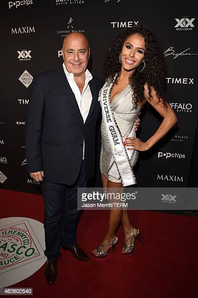 Maxim Publisher Kevin Martinez and Miss Guam Universe Brittany Bell attends the Maxim Party with Johnnie Walker Timex Dodge Hugo Boss Dos Equis...