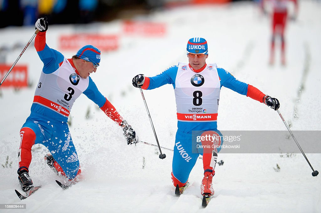 Maxim Vylegzhanin of Russia crosses the finish line in competition with teammate Alexander Legkov after the Men's 15km Classic Pursuit at the FIS Cross Country World Cup event at DKB Ski Arena on December 30, 2012 in Oberhof, Germany.