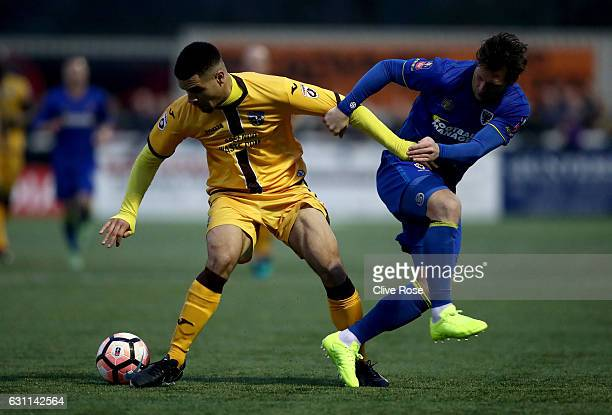 Maxime Biamou of Sutton United and Dannie Bulman of AFC Wimbledon in action during The Emirates FA Cup Third Round match between Sutton United and...