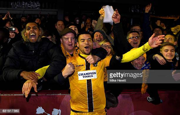 Maxime Biamou of Sutton United celebrates with the Sutton United fans during the Emirates FA Cup third round replay between AFC Wimbledon and Sutton...