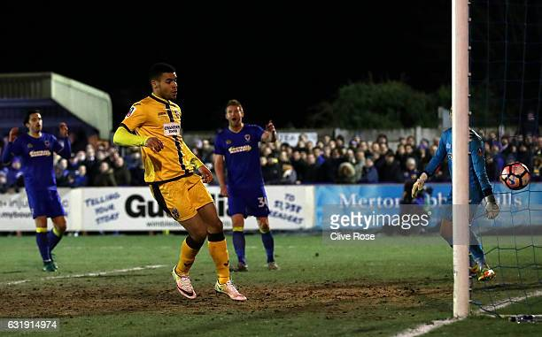Maxime Biamou of Sutton United scores his sides second goal during the Emirates FA Cup third round replay between AFC Wimbledon and Sutton United at...