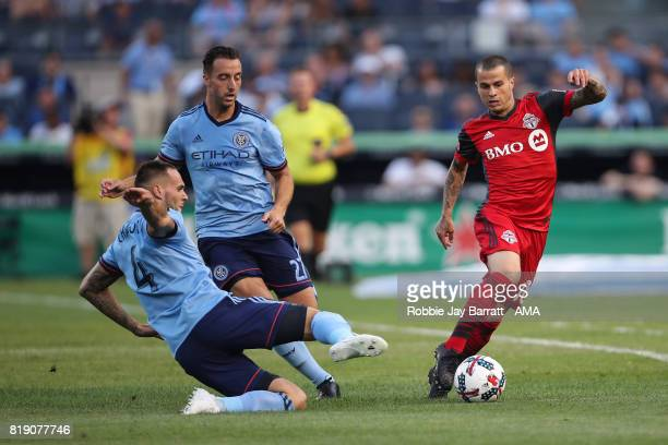 Maxime Chanot of New York City and Sebastian Giovinco of Toronto FC during MLS fixture between Toronto FC and New York City FC at Yankee Stadium on...