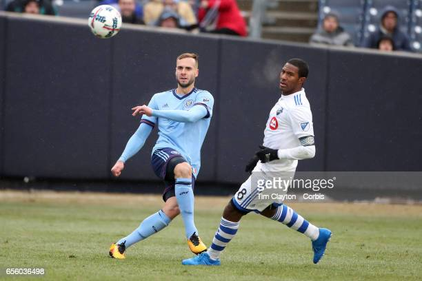 Maxime Chanot of New York City FC clears while challenged by Patrice Bernier of Montreal Impact during the New York City FC Vs Montreal Impact...