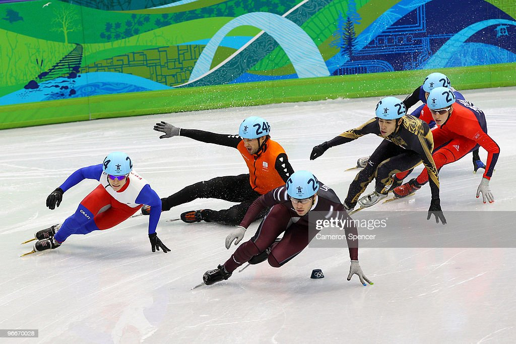 <a gi-track='captionPersonalityLinkClicked' href=/galleries/search?phrase=Maxime+Chataignier&family=editorial&specificpeople=504686 ng-click='$event.stopPropagation()'>Maxime Chataignier</a> (L) and Haralds Silovs of Latvia lead (3L) of France lead the pack as <a gi-track='captionPersonalityLinkClicked' href=/galleries/search?phrase=Niels+Kerstholt&family=editorial&specificpeople=771862 ng-click='$event.stopPropagation()'>Niels Kerstholt</a> (2L) of Netherlands falls on day 2 of the Vancouver 2010 Winter Olympics at Pacific Coliseum on February 13, 2010 in Vancouver, Canada.